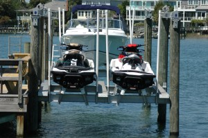 jet ski lift with dual sets of bunks set to different heights for when you only need one jet ski so the other wont float away